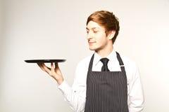 Young waiter. Standing in white studio stock photo