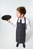 Young waiter. Standing in white studio stock image