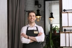 Young waiter in apron. At workplace Royalty Free Stock Images