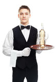 Young waiter with bottle of white Stock Image