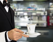 Young waiter with coffee Stock Photo