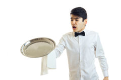 The young waiter open-mouthed drops a tray of crockery Stock Photos