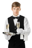 Young waiter serving champagne on a tray Stock Images