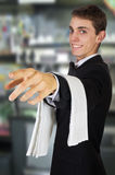 Young waiter in work uniformon Stock Photography