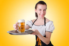 Young waitress with beer. On white Stock Images