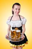 Young waitress with beer Royalty Free Stock Photos
