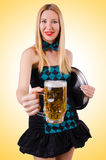 Young waitress with beer Royalty Free Stock Photo