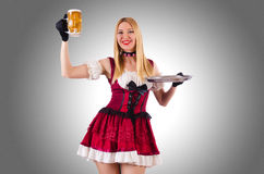 Young waitress with beer Stock Photography