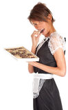Young waitress with box of chocolates Stock Image