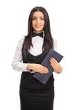 Young waitress holding a menu Stock Photos
