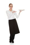 Young waitress holding tray Royalty Free Stock Images