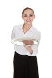Young waitress holding tray Stock Image