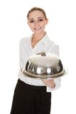 Young waitress holding tray and lid Royalty Free Stock Images
