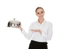 Young waitress holding tray and lid Royalty Free Stock Photo