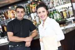 Young waitress at service in restaurant stock photography