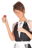 Young waitress with strawberry Royalty Free Stock Photography
