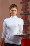 The young waitress with a tray in hand Stock Images