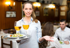 Young waitress at work in restaurant Stock Photos