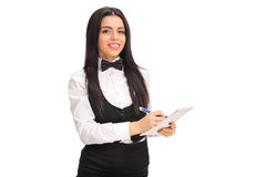 Young waitress writing on a notepad Stock Images