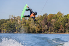 Young Wakeboarder Performing Tricks Royalty Free Stock Photos