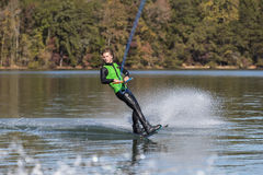 Young Wakeboarder Performing Tricks Stock Photo