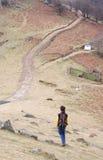 Young walking down the mountain Stock Photo