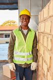 Young warehouse worker as a specialist warehouse trainee royalty free stock photo