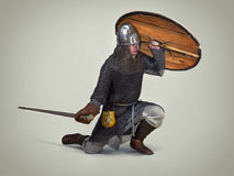 Young warrior of the early middle ages. Young man in clothes and armour from the early middle ages stock photo