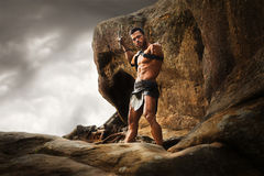 Young warrior on a mountain peak Stock Photos