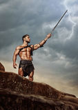 Young warrior on a mountain peak Royalty Free Stock Images