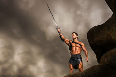 Young warrior on a mountain peak Stock Image