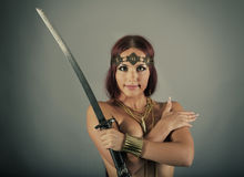 Young warrior woman. Holding sword in her handn Stock Image