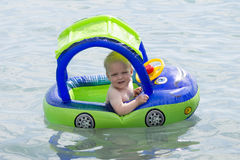 Young water taxi driver. Cute toddler on the sea.  Stock Image
