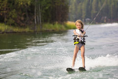 Young Waterskier on a beautiful scenic lake Royalty Free Stock Images