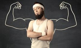 Young weak man with drawn muscles Royalty Free Stock Images