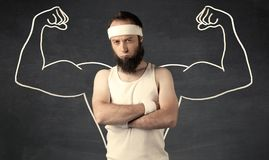 Young weak man with drawn muscles Royalty Free Stock Photos