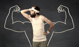 Young weak man with drawn muscles Royalty Free Stock Photo