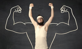 Young weak man with drawn muscles Stock Photography
