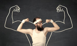 Young weak man with drawn muscles Stock Images