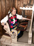 Young weaving woman. In the village of Dragomiresti you can visit to the Museum of Farmers' Wives from Maramures Stock Photos