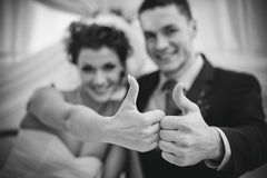 Young wedding couple. Showing success sign. Focus on hands Royalty Free Stock Image