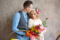 Young wedding couple against texture wall Stock Photo