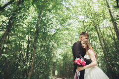 Young wedding couple, bride and groom posing on a railway track Royalty Free Stock Photo