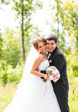 Young wedding couple enjoying romantic moments outside on a summer meadow Royalty Free Stock Image