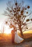 Young wedding couple enjoying romantic moments and walking stock photo