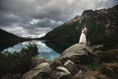 A young wedding couple enjoys a mountain view on the shore of a lake Morskie Oko royalty free stock photo