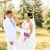 Young wedding couple  in funny big glasses Stock Photo