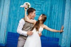 Young wedding couple having fun Stock Photos