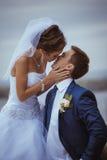 Young wedding couple kissing Stock Photos