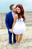 Young wedding couple kissing Royalty Free Stock Photos